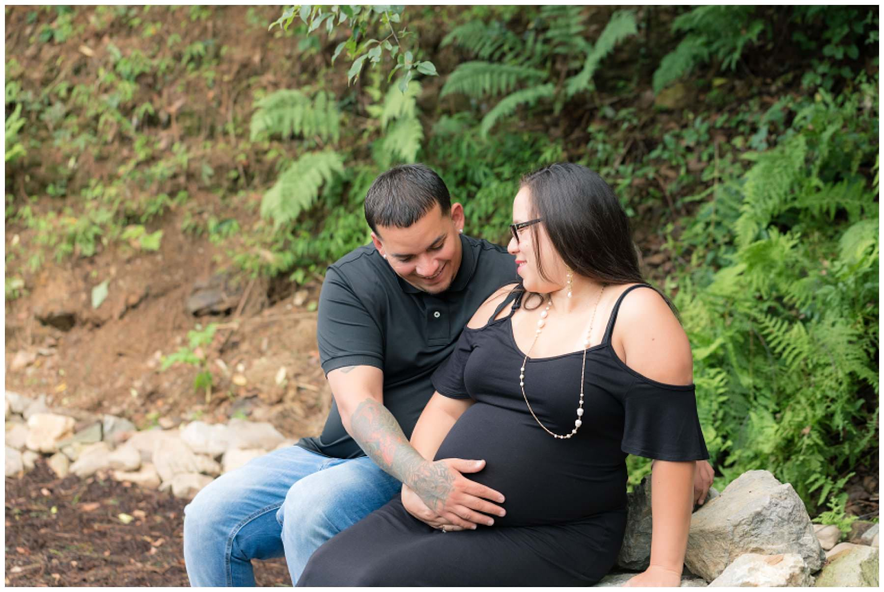 Outdoor maternity photos of couple wearing black