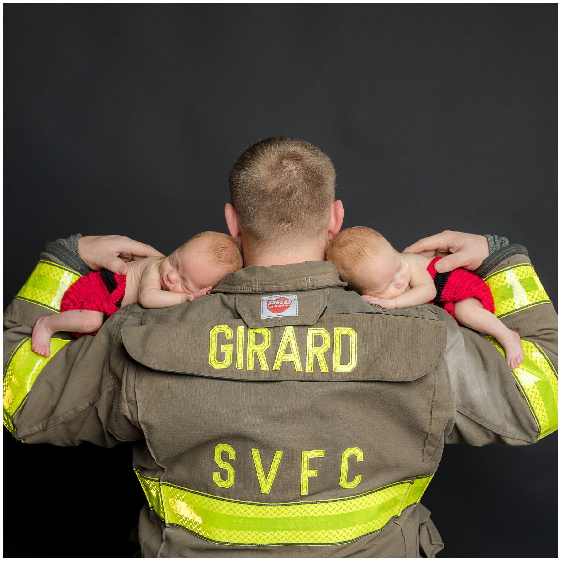 firefighter themed newborn twin photo in studio